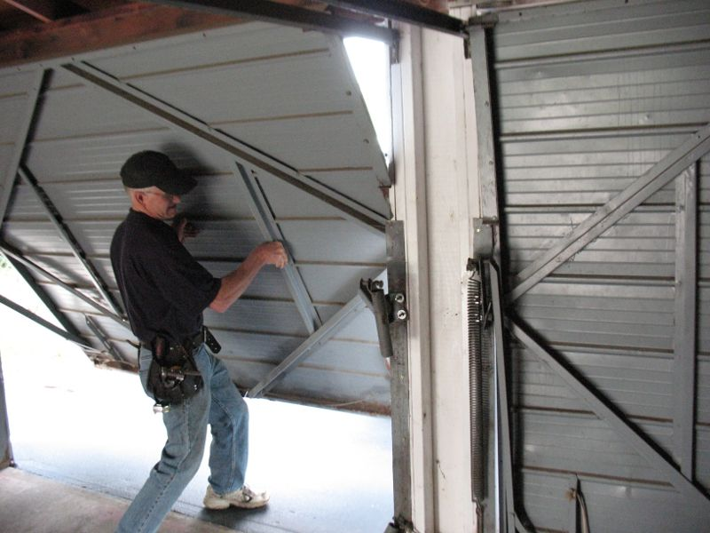 A garage door repair Minnesota expert double checks a repair